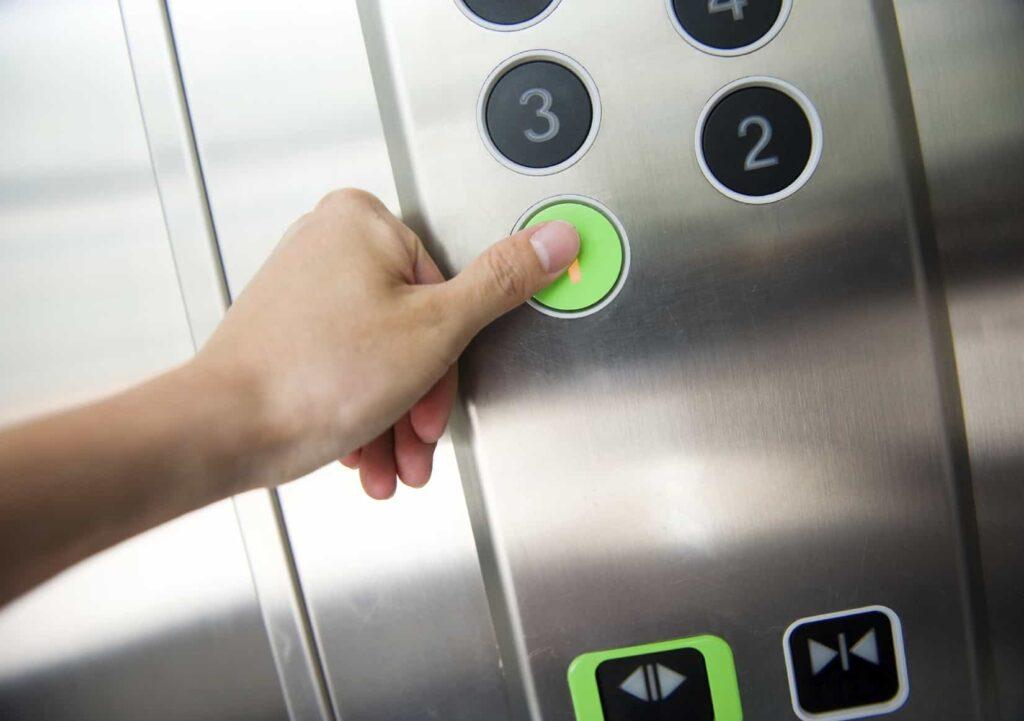 Man hand press 1 floor in elevator.