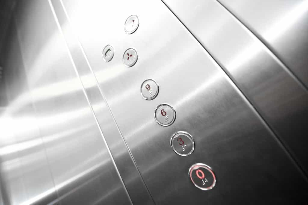 Interior and closeup of metal buttons in elevator