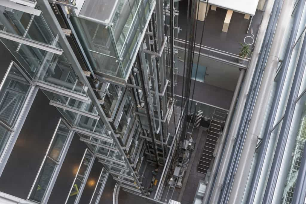Looking downwards in a modern open elevator shaft iStock 000042855584 Medium 1024x682 - THE NEW ERA OF LIFTS THAT'S SET TO REVOLUTIONISE ARCHITECTURE