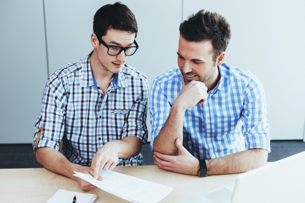 People talking about work iStock 000083757789 Medium 1024x682 - WHAT ARCHITECTS ARE THINKING WHEN THEIR CLIENTS SAY…
