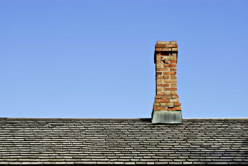 Chimney on Roof iStock 000003269708 Medium 1024x685 - Converting Old Buildings Into Homes: What to Consider?