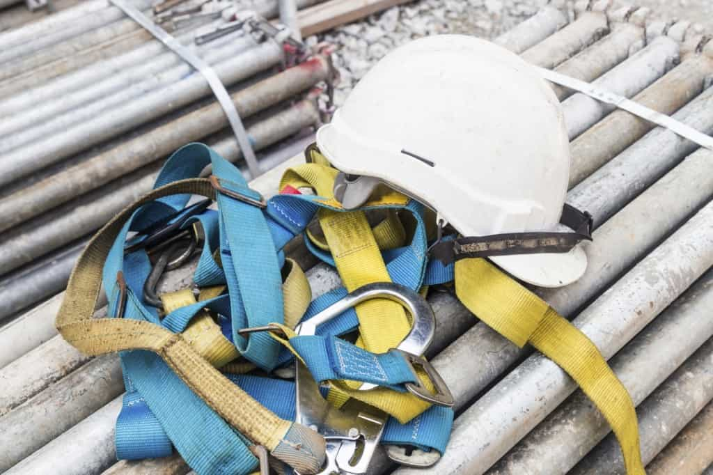 Safety harness and helmet at construction site iStock 000063264039 Medium 1024x682 - Contractors: How to Choose Your Subcontractors