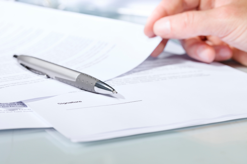 Close up of a silver pen with documents iStock 000075900319 Small - Is Buying Warranty Worth It?
