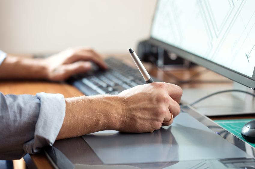 Designer Using Digital Tablet iStock 000079591375 Small - Interior Designers: Working in a Team