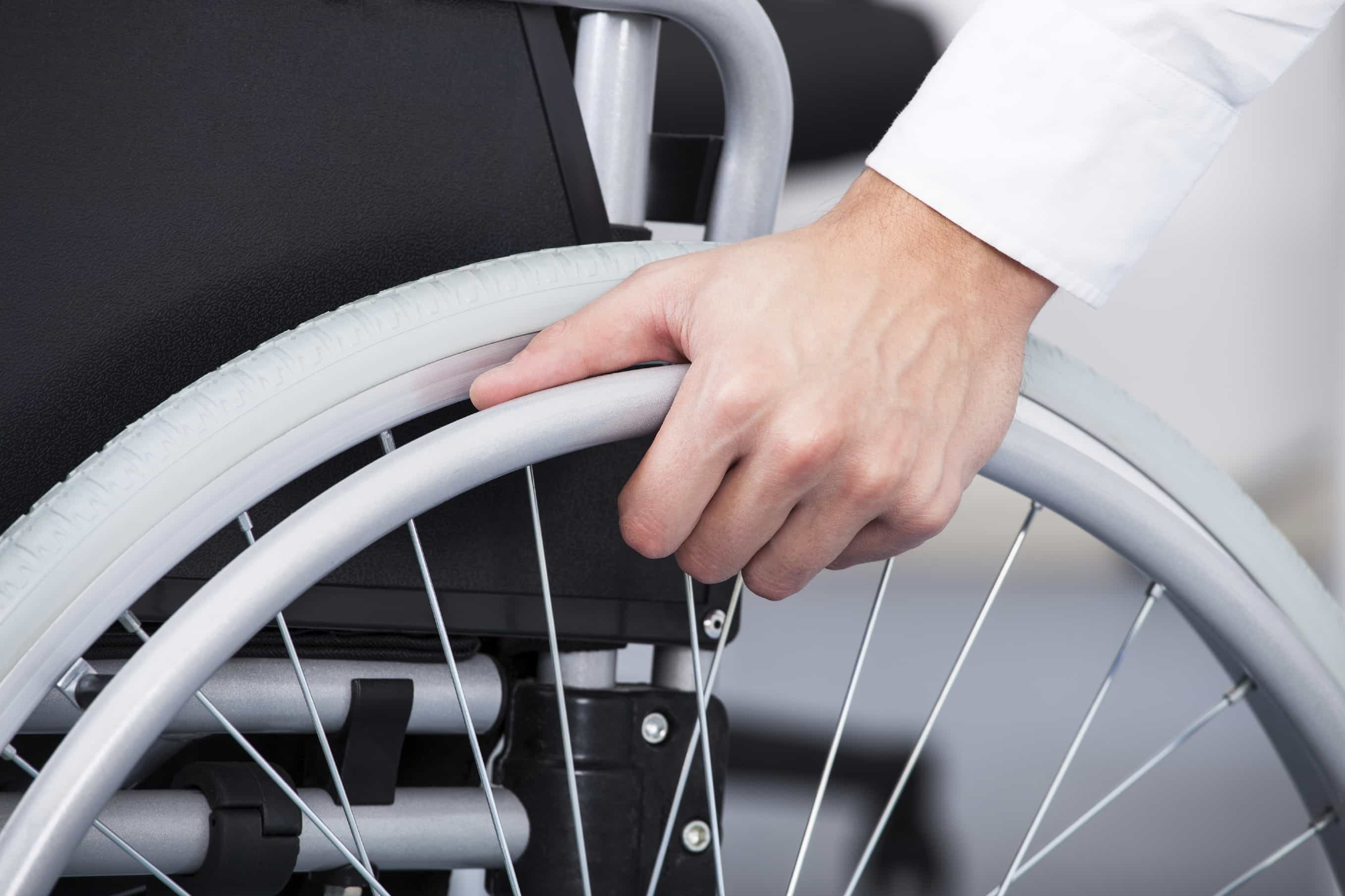 Businessman in Wheelchair iStock 000033518074 Large - DISABLED ACCESS LIFTS IN THE BUSINESS WORLD