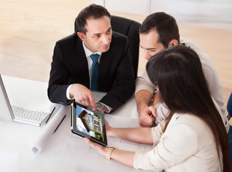 agent with clients iStock 000045101140 Small - How to Create the Perfect Team Using the Right People for the Right Job
