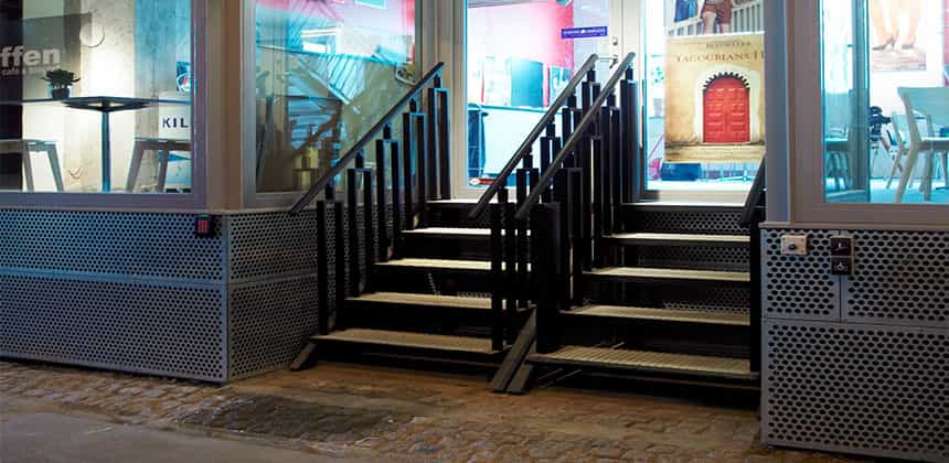 Access Products Steps - Complex triple entry low pit lift installed in historic Market Hall